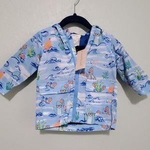 NWT First Impression baby rain coat. 6-9M